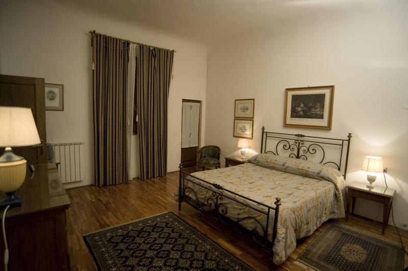 Dormitorio con terraza