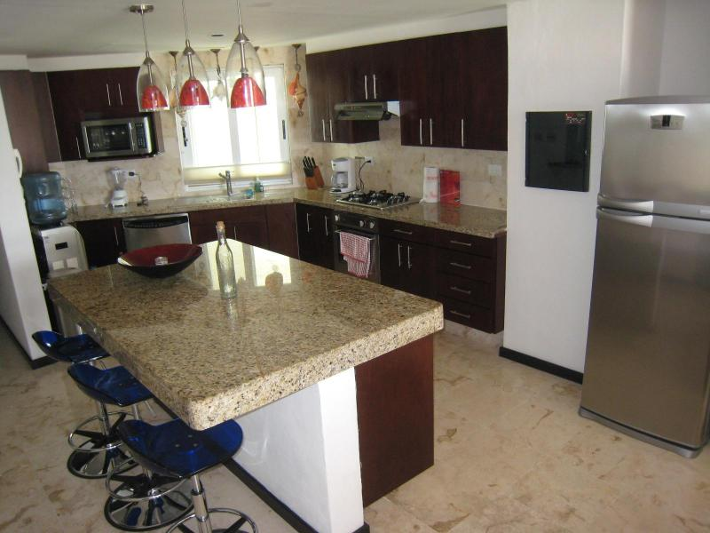 Fully fitted kitchen with granite counter tops, well stocked with pots, pans, cookware ans tableware