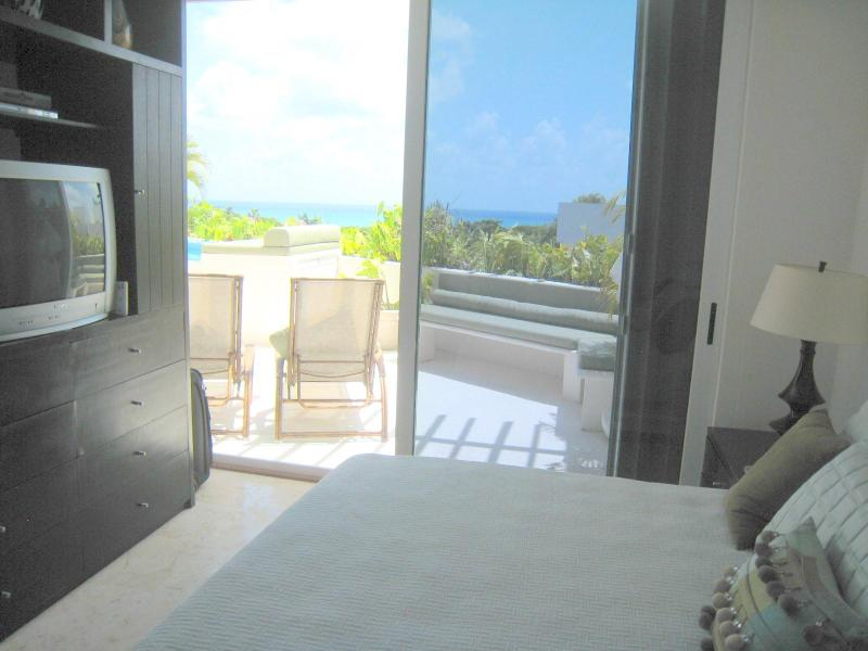 Bedroom 1 has ocean views and access directly onto the terrace