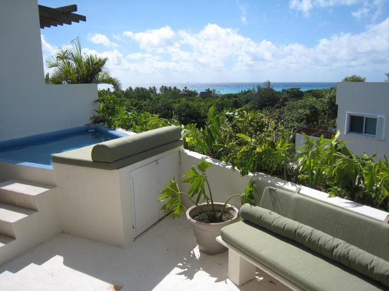 View from terrace, with sun loungers and additional seating and chairs