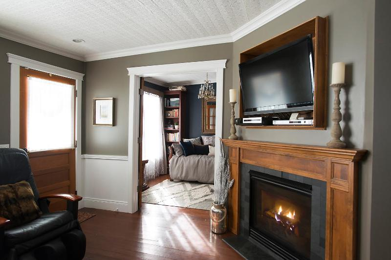 View from living room with gas fireplace into library with trundle bed.