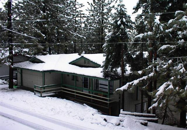 Exterior view in winter, showing street-level entry and front porch