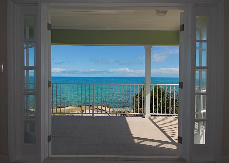 Master bed room with open French Doors to balcony overlooking the ocean