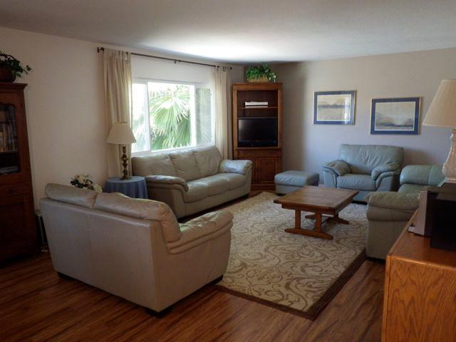 Newly remodeled living room with new flooring and 32' interactive, flat screen TV.