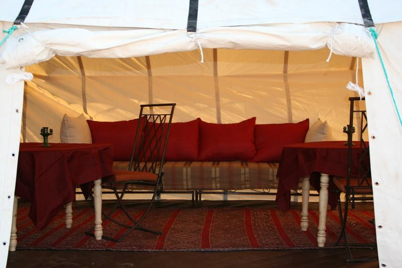 Looking into the comfortable salon tent