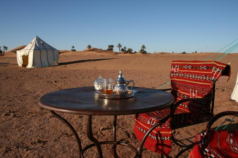 Wake-up to mint tea, served at your tent