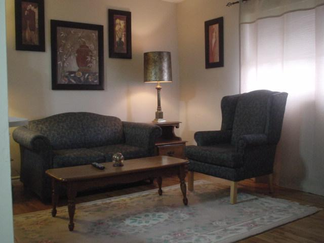 Suite 2. This Room is Tastefully Decorated with high Wing Back Chairs and Matching Pull Out Sofa.
