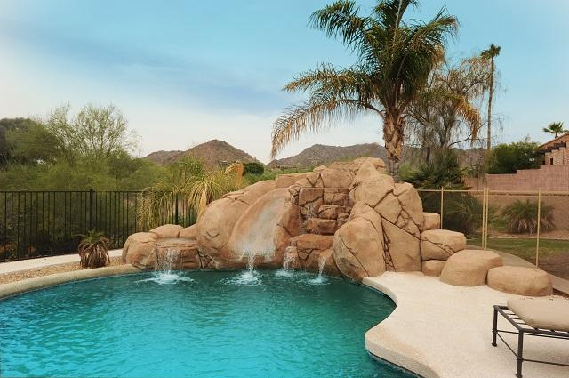 Heated pool and spa with family fun pool slide, waterfall, pool table, etc...