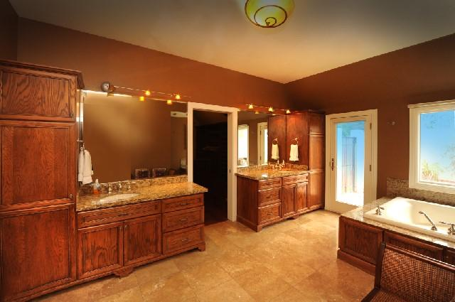 MASTER BATHROOM WITH 3 VANITIES, WALKIN SHOWER AND LARGE JETTED TUB