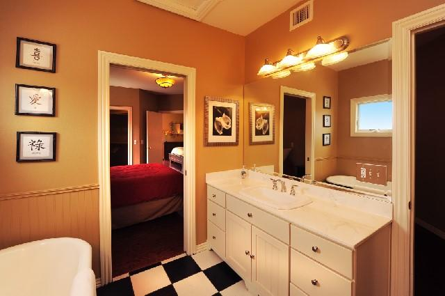 GUEST BATHROOM HAS 2 VANITIES, WALK IN SHOWER AND BALL AND CLAW BATH TUB