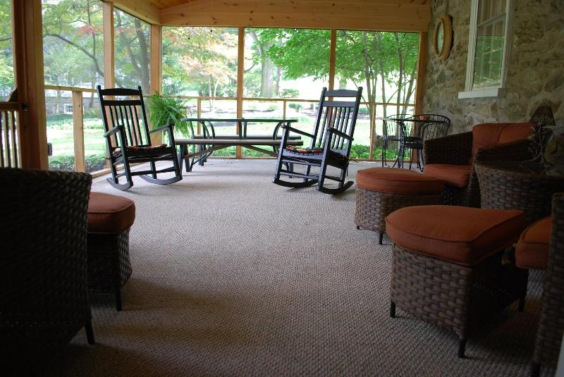 22' screened porch with lots of comfy seating and grill for cook-outs.