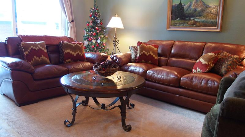 Large Living Room with Fireplace, HD Large Screen TV, New Leather Couches next to dining and Kitchen