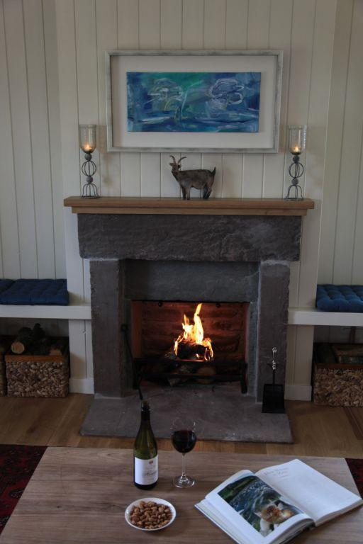Enjoy an atmospheric open Log Fire in the Lounge area. with solid oak floors and underfloor heating.