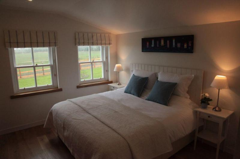 Beautiful bright Bedroom with Superking sized Bed with crisp Egyptian linen, views over Crieff Hills