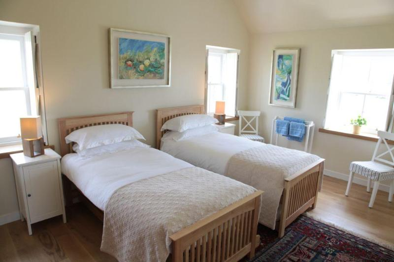 bright and very spacious twin room with three windows showing stunning views South, East and West