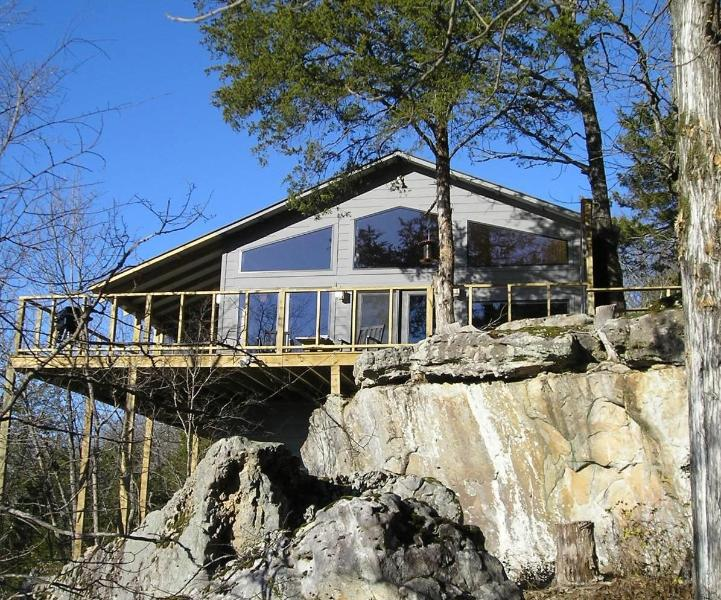 Each cabin or suite has a glass wall facing the lake.