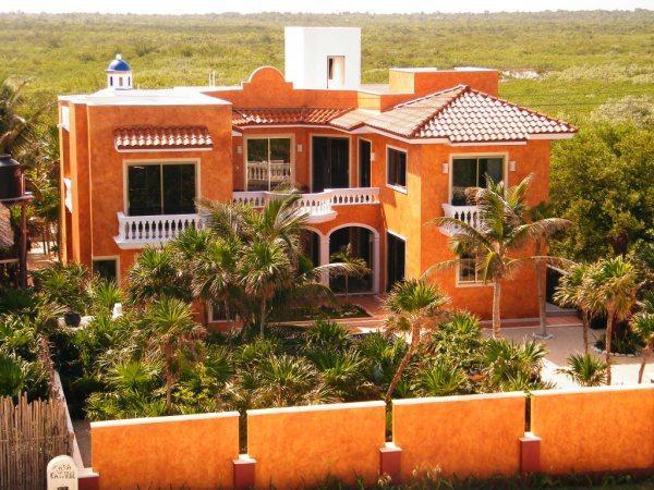 Aerial view of house exterior facing jungle