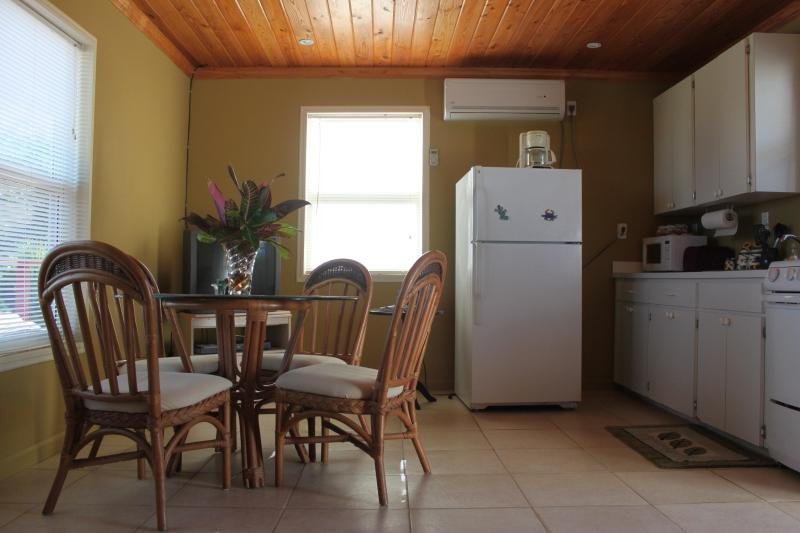 Downstairs is spacious, an open room. Dine with ocean views! Kitchen is well equipped.