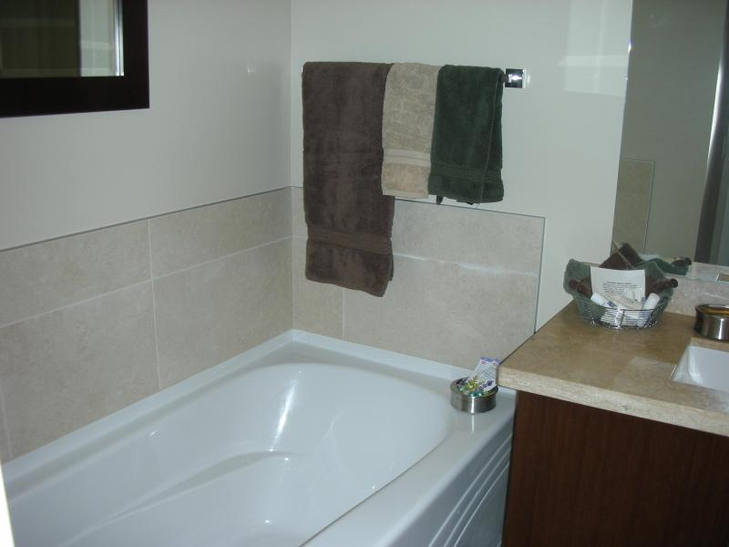 Deep soaker tub with bath oils and bubble bath included