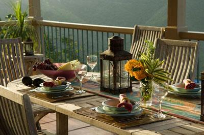 The dining area outdoors, on a covered deck with one of the most magnificent island views around