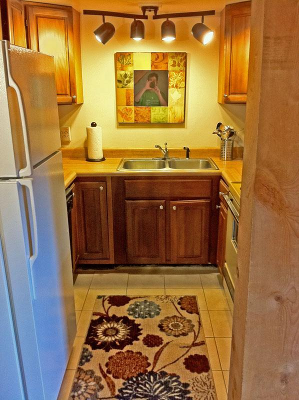 Left: The kitchen has a new fridge and is fully equipped.