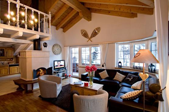 High ceilinged living room with wood fire place