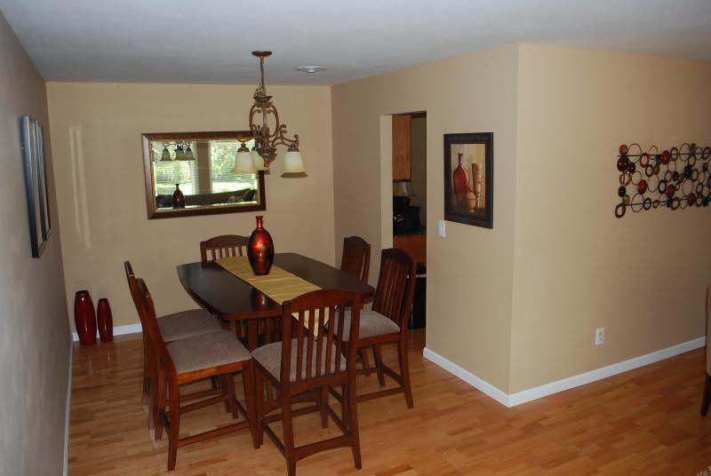 Dining Room with Counter Height Table and Six Chairs