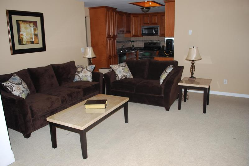 Family Room Sofa & Love Seat View Looking Towards Kitchen.