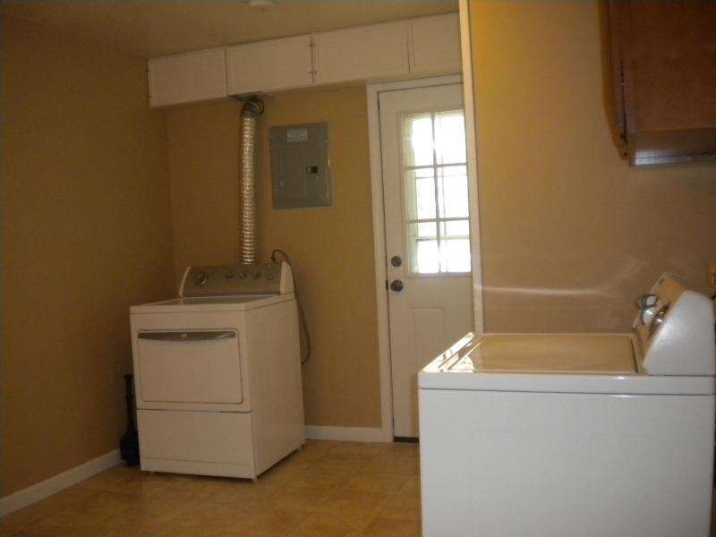 Huge Laundry Room With Exit to Patio