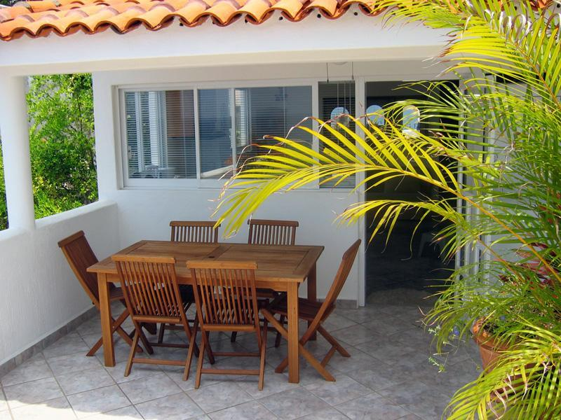Outdoor Dining table under Porch on Private Patio