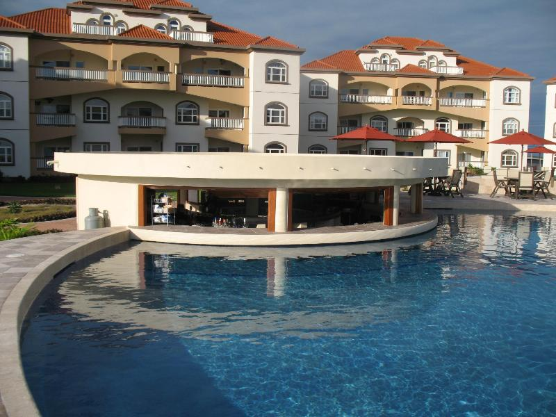Grand Caribe's Main Pool with Swim-Up Bar.  Perfect for Ordering Food and Drinks!