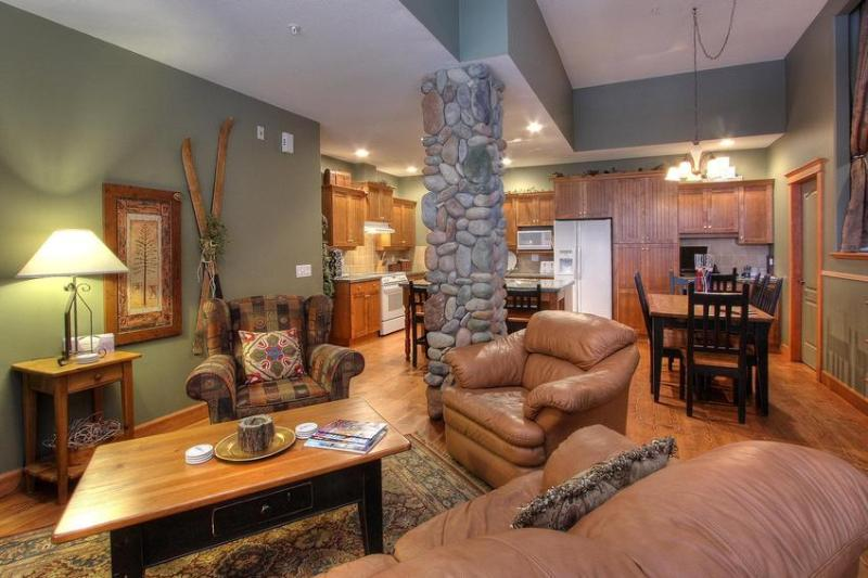 Another angle of the open living room, eating and kitchen area