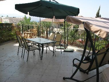 spacious patio with swing, table & chairs, shanty sofa