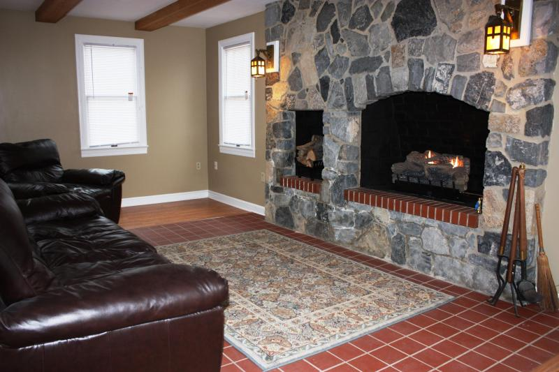 huge stone fireplace in great room with leather sofas