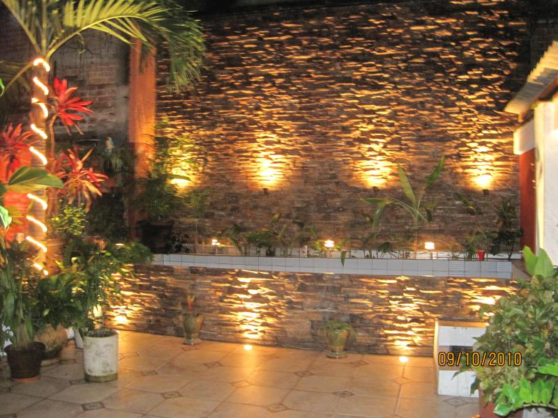 Courtyard, dipping pool, backwall waterfall, surrounded by lot of tropicale flower and vegetation