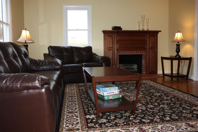pull out leather sofa, love seat, fire place and big screen tv in sitting room