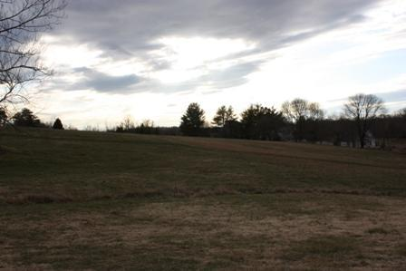 field in the back of home in the winter