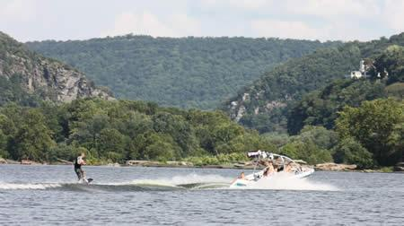 wake boarding on the Potomac River with the Harpers Ferry Gap in the background