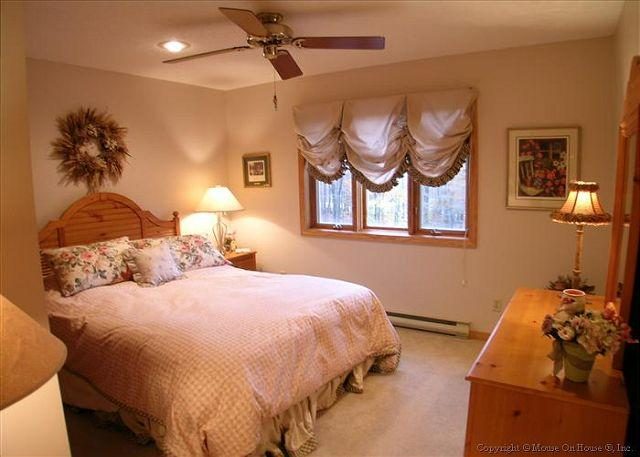 Lovely upstairs bedroom with queen bed.