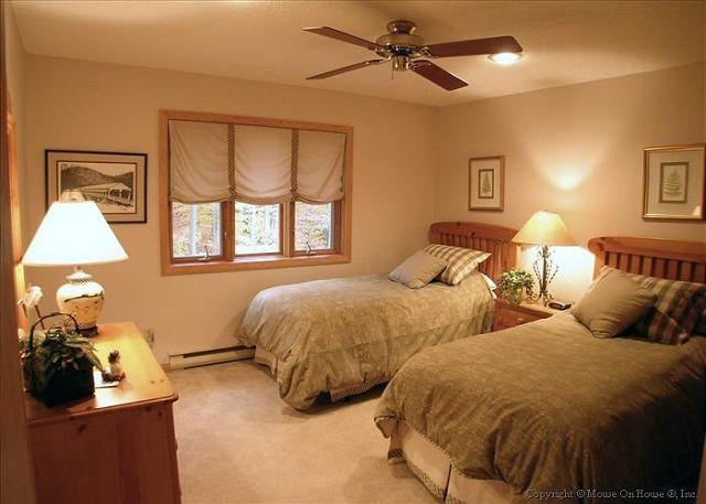 Comfortable upstairs bedroom with twin beds.