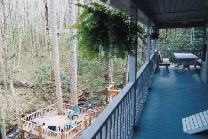 view of side porch overlooking the creek