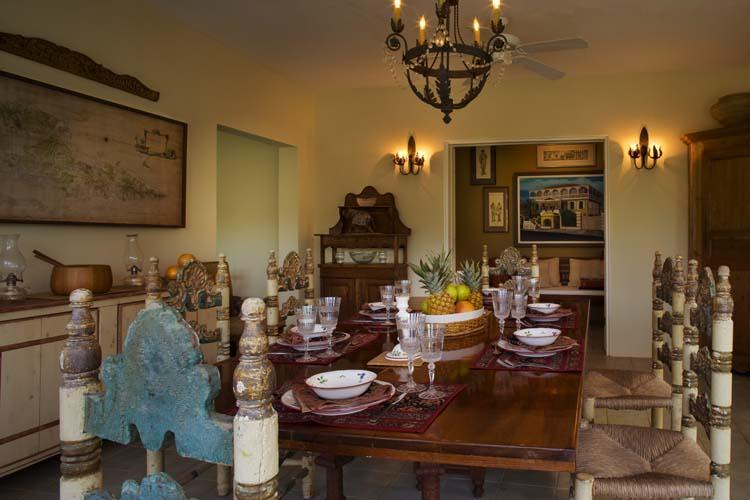 Locally handmade mahogany dining table with hand-painted antique Mexican chairs