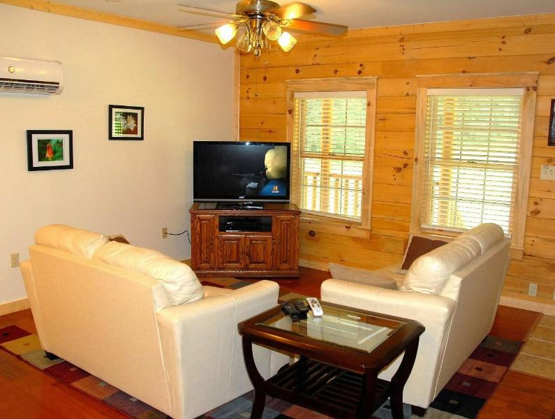 Living room features 46' flat screen with DirecTV and new leather furniture.