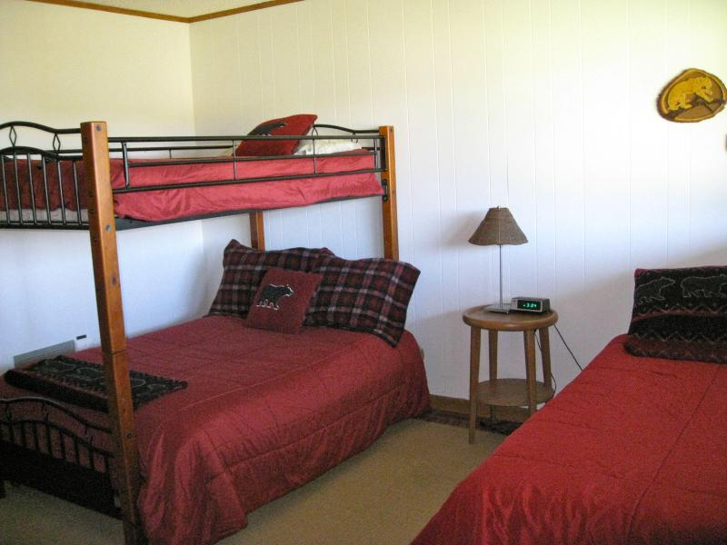 Full bed, twin bed & upper bunk with view of lake