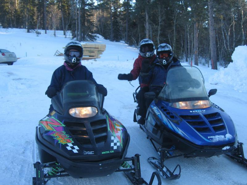 snow mobling with friends at the cabin