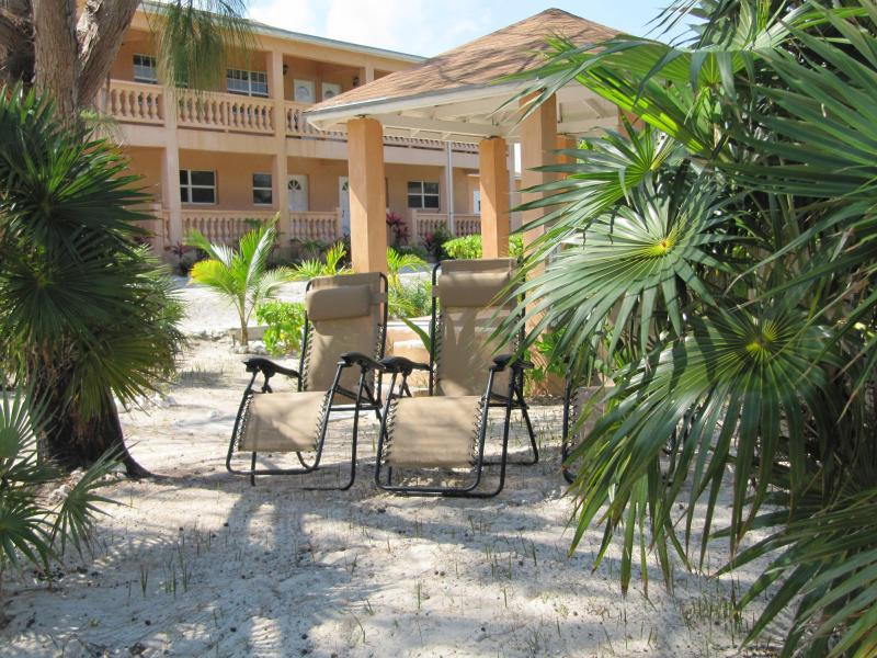 Cedar Palm Suites overlooking the gazebo and beach lounge chairs