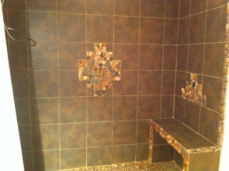 downstairs bathroom with rock shower, next to sauna