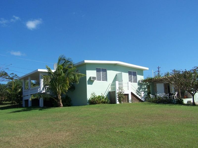 Spacious private grounds with a lovely ocean view  Back view shows casita off patio