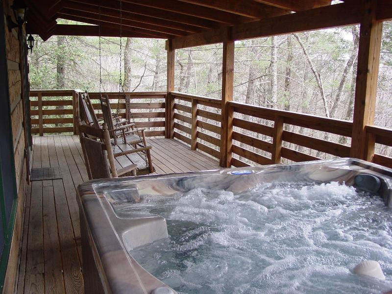 Brand New 6 Person Hot Tub Located on Covered Porch with Swing & Rocking Chairs