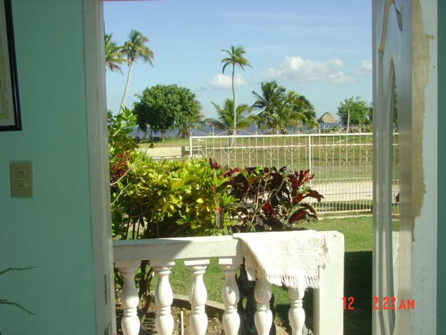 looking out door to the seashore